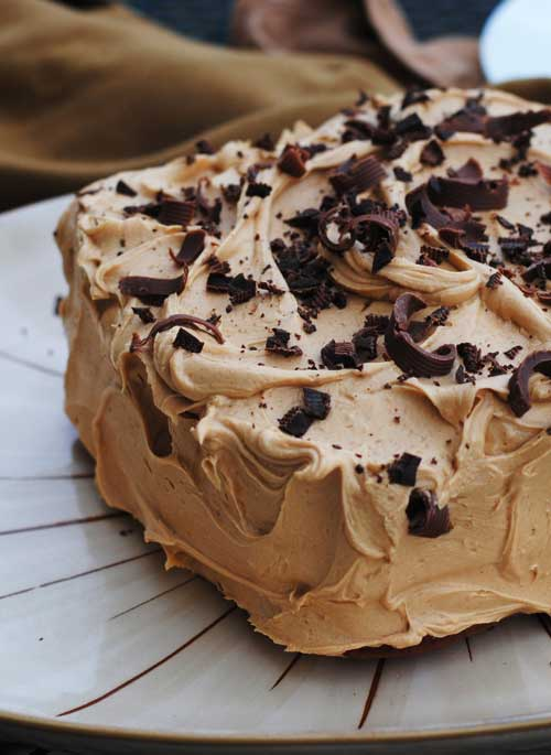 This Banana Chocolate Chip Cake with Peanut Butter Frosting is, at it's core, is a very moist, rich banana bread, dressed up in peanut butter frosting. #banana #chocolate #cake #dessert
