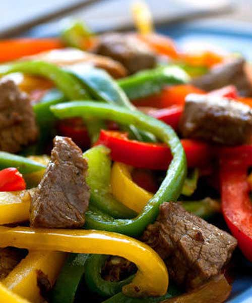 In this version of a stir-fry classic, Rainbow Beef, I am using less beef than a typical recipe would call for and adding in some shiitake mushrooms and extra peppers