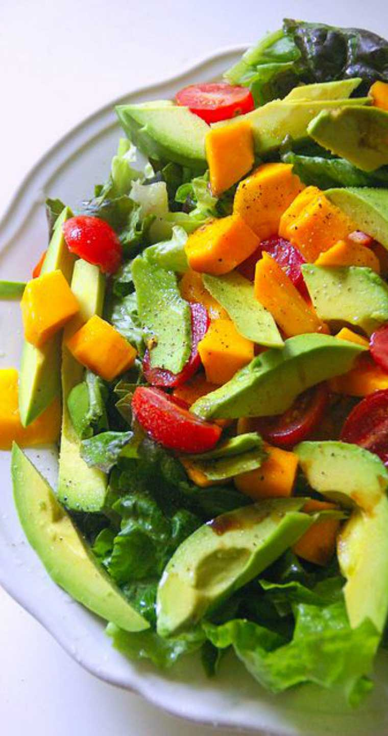 This easy to prepare Avocado Mango and Tomato Salad brings to mind all of the beautiful, fresh, and tropical flavors of South America. #salad #sidedish #avocado #mango #tomatoes #healthy