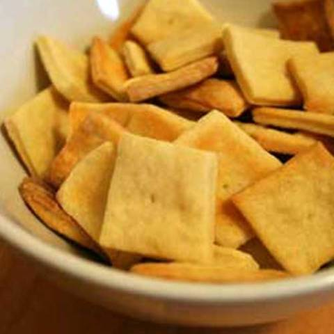 Recipe for Homemade Cheese Crackers - These are surprisingly easy, and I was impressed by how much like Cheez-its they taste. The hardest part was definitely rolling the dough thin enough to produce a sufficiently crispy cracker.