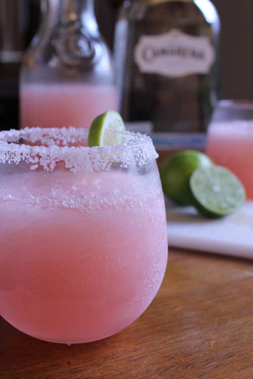 Recipe for Pink Grapefruit Margaritas - These margaritas will certainly liven up your weekend, both refreshing and delicious. They are super simple to make, the only catch being, you need fresh limes, it really makes a difference. Make these at your next party, they are sure to be a hit.