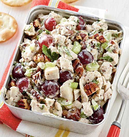 Recipe for Poppy Seed Chicken Salad - Go tropical and substitute chopped pineapple for the grapes and macadamia nuts for the pecans. Stir in about 1/2 cup coconut for more island flavor.