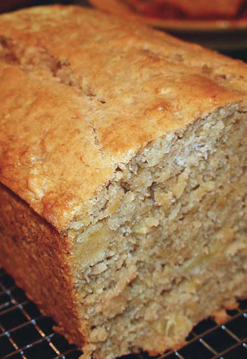 Recipe for Tropical Pineapple Coconut Banana Bread -  I've made many kinds of banana bread recipes, but this remains my absolute favorite. It's also one of the more popular recipes on my blog. If you're looking for a very moist, dense cake with loads of bananas… this is your recipe. Add some extra tropical flavors like pineapple, cream of coconut and macadamia nuts and you'll be in heaven!