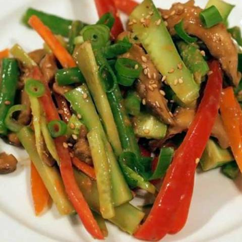 Recipe for Crunchy Cucumber Salad with Sesame and Peanut Dressing - This dish would be a great vegetarian option at a summer picnic or barbecue–feel free to make it earlier in the day and let it chill out a bit in your fridge.