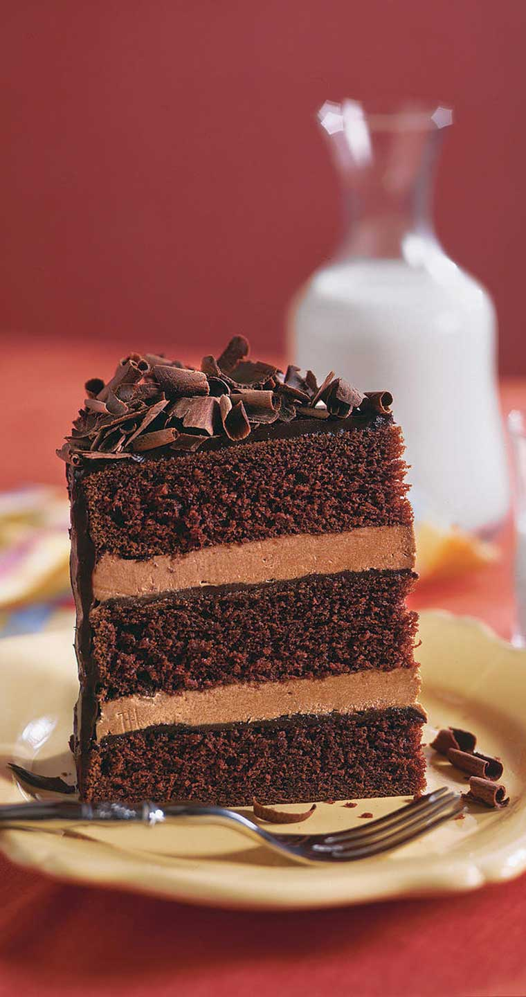 ThisChocolate Cake with Whipped Cream Frosting is a simple and easy to prepare chocolate cake recipe that uses two favorite foods: chocolate cake and chocolate whipped cream frosting. #chocolate #cake #dessert