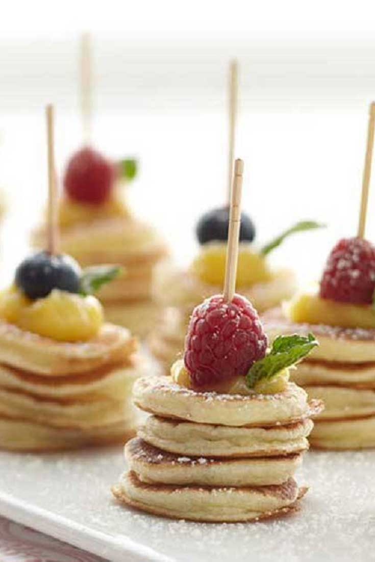 These Mini Pancake Stacks would be a cool way to display breakfast in the morning for guests or for a shower! #pancakes #breakfast #fruit #showerfood