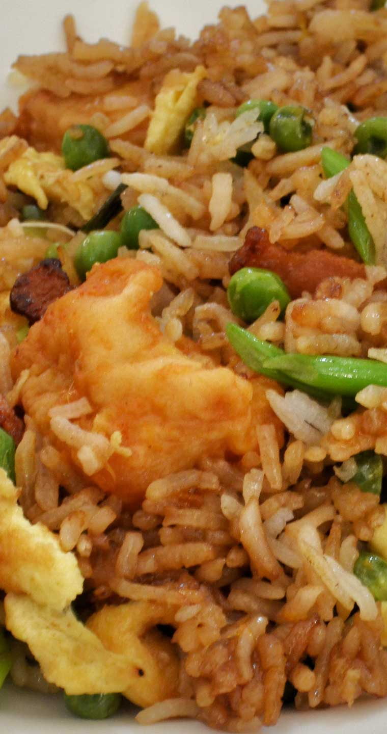 Spicy and sweet Orange Chicken with Fried Rice. You may never order take-out again after trying this recipe! #chicken #Chinese #dinnerideas #orange