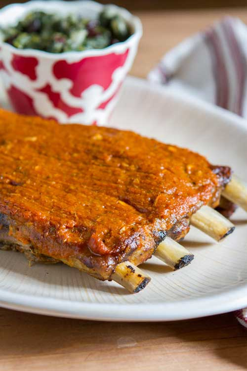 Recipe for Slow Cooker Pork Spare Ribs with Spicy Peach-Mango BBQ Sauce - These slow cooker pork spare ribs are comfort food at its finest.