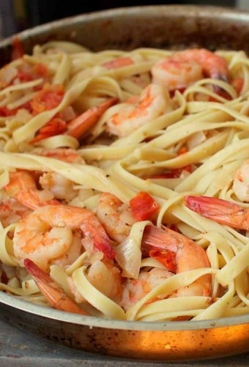 The key to this super simple sauce is the tiny tomatoes. Not only are they an easy ingredient to work with, they also lend a slight sweetness to this Shrimp Fettuccine in Cherry Tomato Sauce.