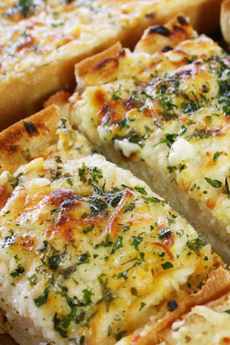 We love all varieties of bread, but this Bubbly Cheese Garlic Bread is our favorite. Add a little garlic, some butter, a bunch of cheese, and throw it in the oven…and we're in heaven! #bread #cheese