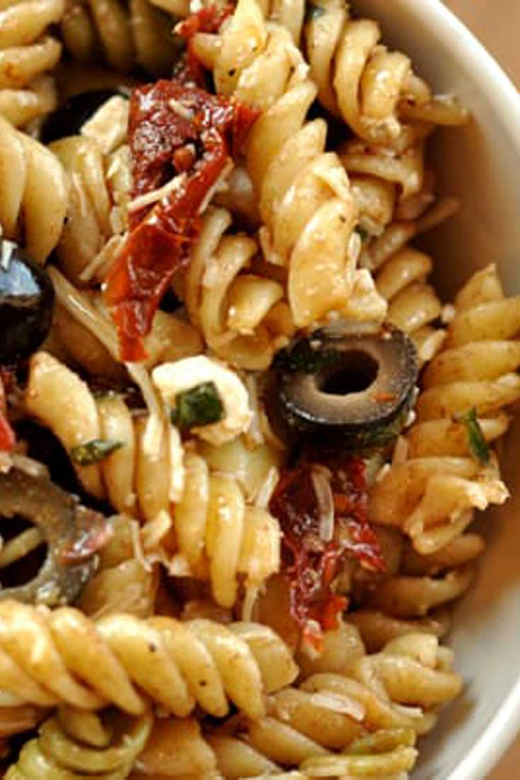 This colorful Mediterranean Pasta Salad recipe comes together in minutes and is sure to steal the show at any picnic or dinner table. #pasta #salad #sidedish #easyrecipe