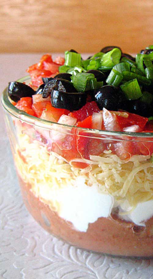 Without a doubt, my favorite party food is seven layer dip. With one deft swoop of a wide-brimmed tortilla chip, you can shovel seven unique tastes and textures into your open mouth at once.