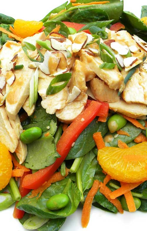 Loaded with fresh, vibrant veggies, tender poached chicken and a flavorful dressing, this salad makes for a satisfying meal.