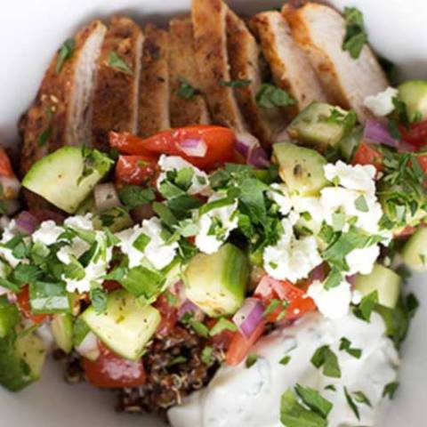 These Greek Chicken Quinoa Bowls are a quick and healthy meal to prepare for the family. This dinner has it all - whole grains, vegetables, lean protein and a light yogurt sauce.