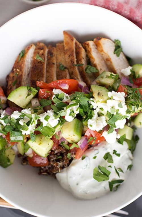 These Greek Chicken Quinoa Bowls are a quick and healthy meal to prepare for the family. This dinner has it all - whole grains, vegetables, lean protein and a light yogurt sauce. #chickenrecipe #healthymeal #greekchicken