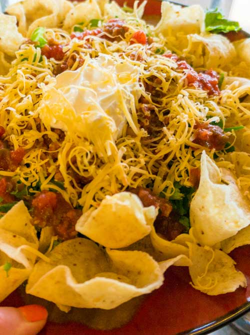 The chili is cooked in the crockpot and the rest of this Deli Style Taco Salad just takes a few minutes to create so it's pretty easy!