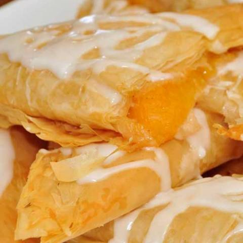 Recipe for Peach Turnovers - Once you make these and see just how easy they are to put together, they will become your go-to breakfast-to-impress. They can also double as dessert.