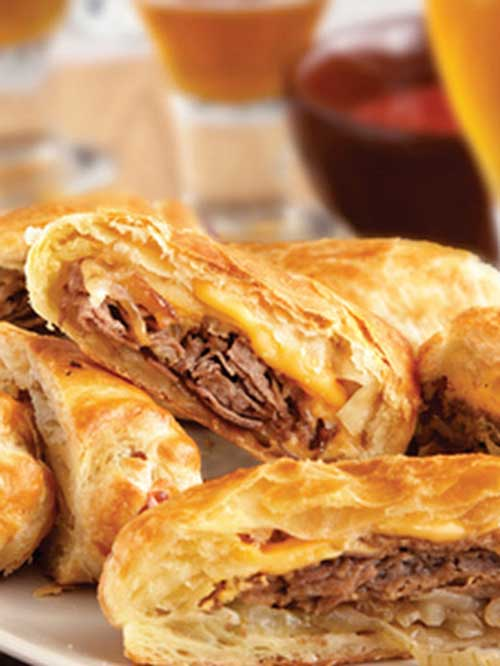 These upscale cheesesteak sandwiches feature flaky puff pastry instead of ordinary rolls. They're easy to make, and even easier to enjoy!