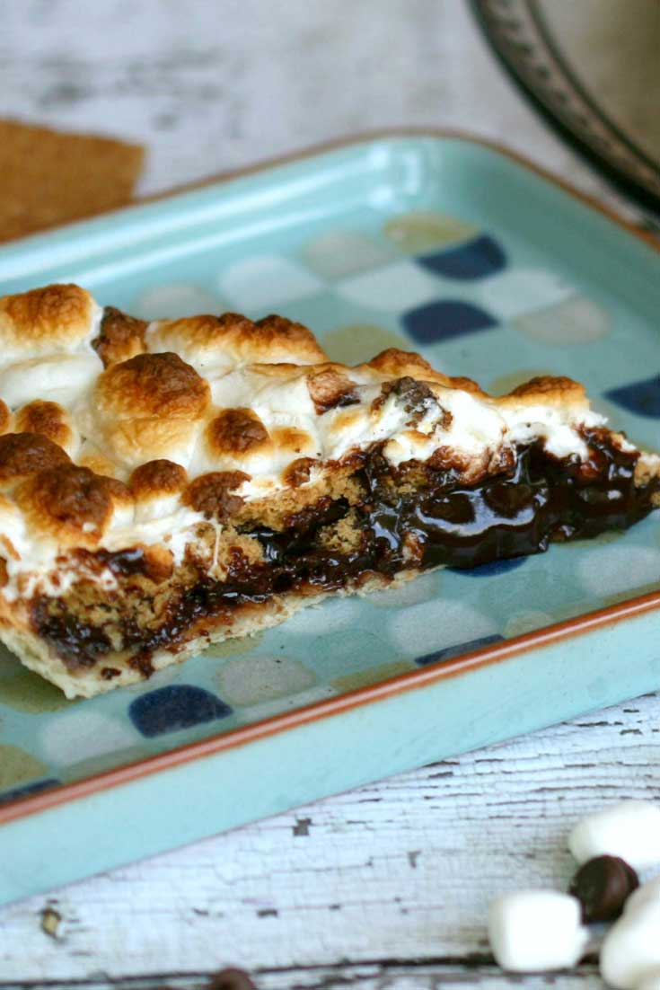Summer is the season on S'mores, and this S'mores Pie has every amazing element of the classic summer treat all inside a homemade pie crust! #chocolate #marshmallow #dessert #pie