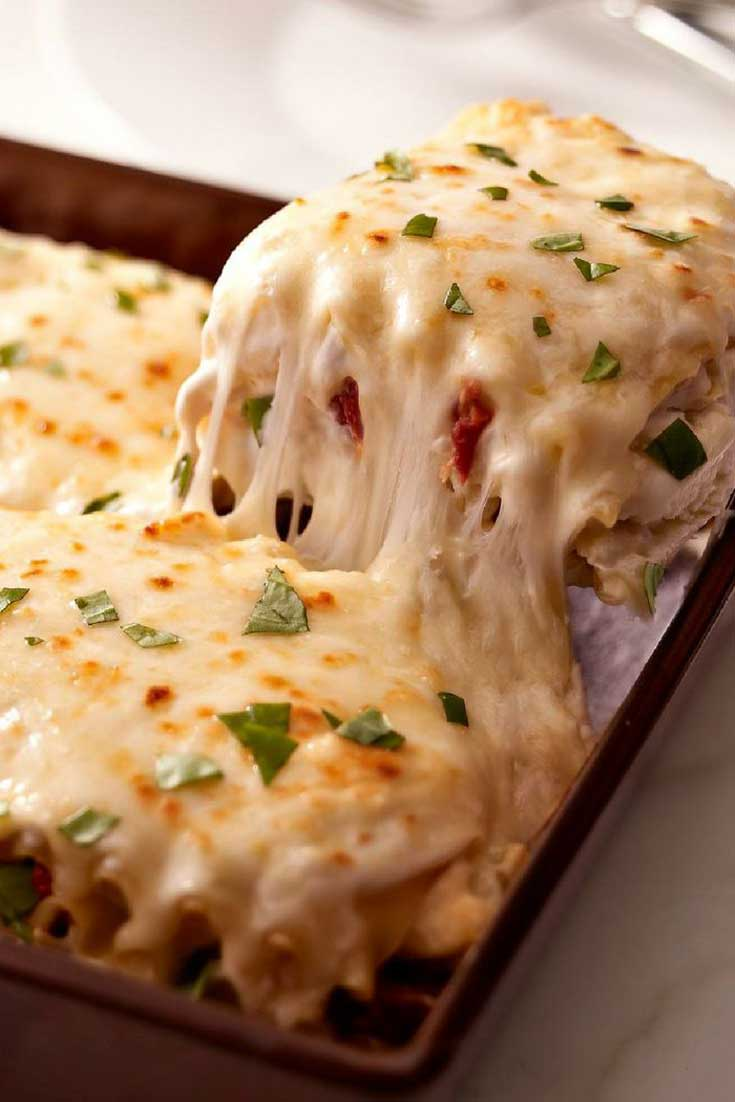 If you love cheesy, creamy goodness, then you will love this Creamy White Chicken Lasagna recipe that takes lasagna to a whole new level! #lasagna #dinnerideas #chicken