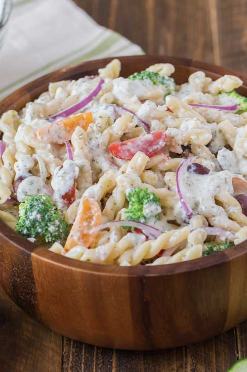 Recipe for Greek Pasta Salad with Cucumber Yogurt Dressing - Try putting a flavorful spin on a classic pasta salad with this Greek version.
