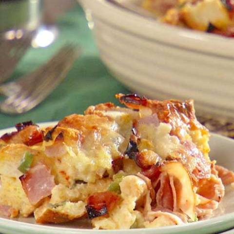 Recipe for Ham and Cheese Strata - This hearty make-ahead breakfast is infused with Dijon mustard and bakes up to a fluffy, golden finish.
