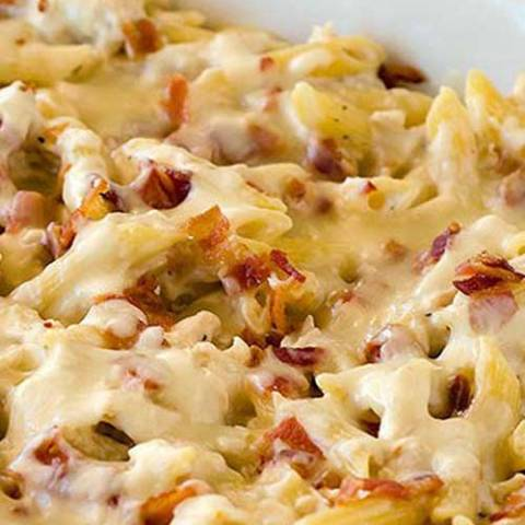 Pasta is infinitely better packed with cheese and baked into a creamy casserole. File this Chicken-Bacon-Ranch Baked Penne recipe under the very definition of comfort food!
