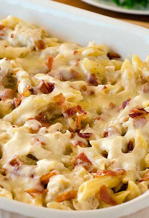 Pasta is infinitely better packed with cheese and baked into a creamy casserole. File this Chicken-Bacon-Ranch Baked Penne recipe under the very definition of comfort food! #chickenpasta #casserolerecipe #pastarecipe #chickenrecipe