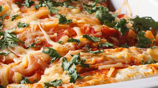 Recipe for Cheesy Chicken Enchiladas - This cheesy chicken enchilada recipe is packed with flavor. A fun dish any night of the week.