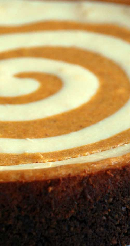 This is the ultimate pumpkin cheesecake. It has a unique gingersnap crust and rich, luscious swirls of cheesecake and pumpkin.