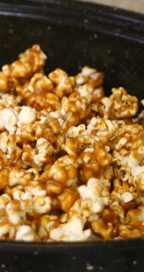 I make at least one large batch of homemade caramel corn every Christmas. It is delicious and everyone raves over it. #caramel #popcorn