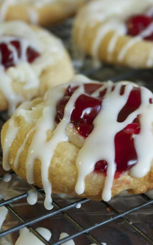 TheseMini Cherry Cheese Danishes a simple, yet beautiful dessert. The crescent rolls are the perfect base for the sweet cream cheese and the tart cherries.
