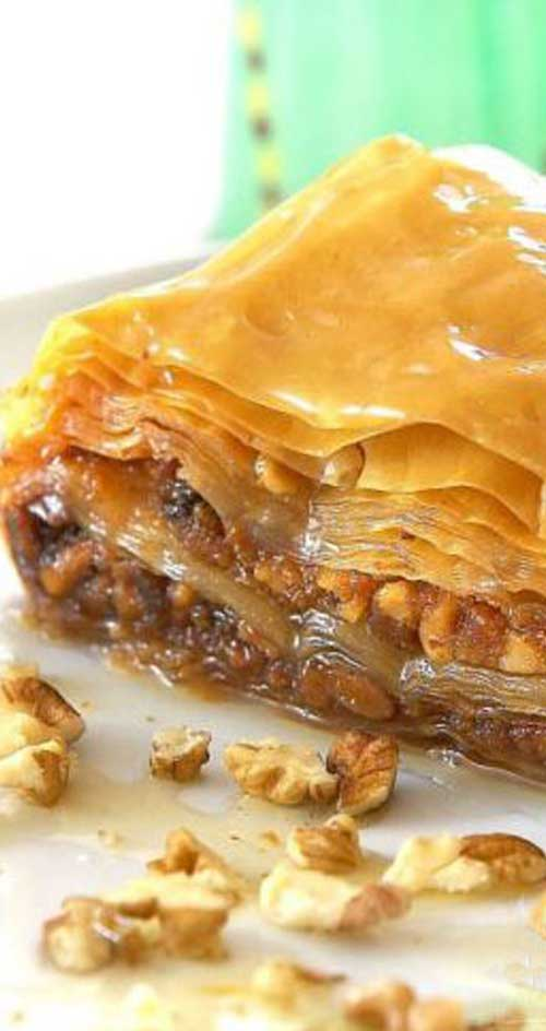 A Greek favorite that makes everyone think you are a master chef and is sooo easy to make! The phyllo dough for this Greek Baklava recipe is found in the freezer section of most grocery stores. #greekfood #greekdessert #dessertrecipe