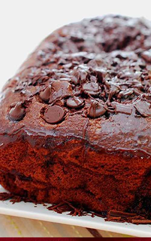 Recipe for Quadruple Chocolate Loaf Cake - Moist, chocolaty, dense, rich - and I think it goes without saying, decadent. I think the most charming thing about this cake is it was probably the easiest dang thing I ever made in my life!