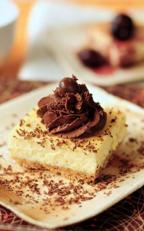 This Zabaglione Cheesecake is a rich, smooth, and delightful cheesecake combination set on an almond crumb base and glazed with a decadent trufle fudge frosting.