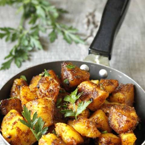 This is a healthy recipe for Bombay Potatoes, a typical Indian dish. Quick and simple, and oh sooo yummy!