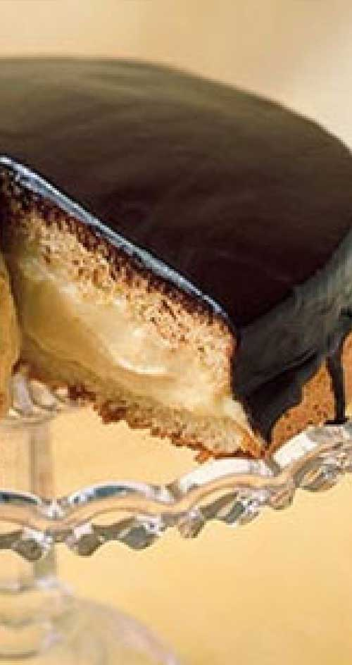 This American classic Boston Cream Pie, first made by a Boston chef in the 1850s, isn't actually a pie at all, it's a cake: two sponge layers with custard-cream filling and a shiny chocolate glaze. #bostoncreampie #dessert #cake