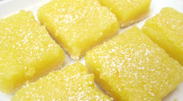 Recipe for Guiltless Lemon Bars - These bars were so light and tasty with a great flaky shortbread crust! They are also pretty easy to make, always a plus! Remember, the powdered sugar on top is crucial–it's just so pretty!