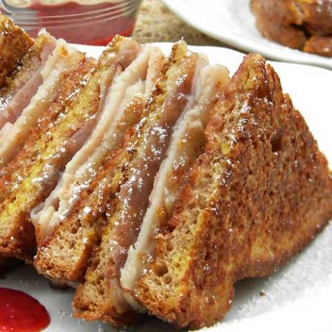 Recipe for Monte Cristo Sandwiches - A Monte Cristo sandwich combines so many yummy flavors. It's a little bit french toast and a little bit grilled cheese and it is great for breakfast, lunch or dinner.
