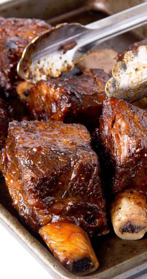 These babies are so good there won't be leftovers! A little bit sweet with just the right amount of mustardy zest. If you're feeding a big crowd, double or triple the recipe. #slowcooker #beef #dinnerideas #shortribs