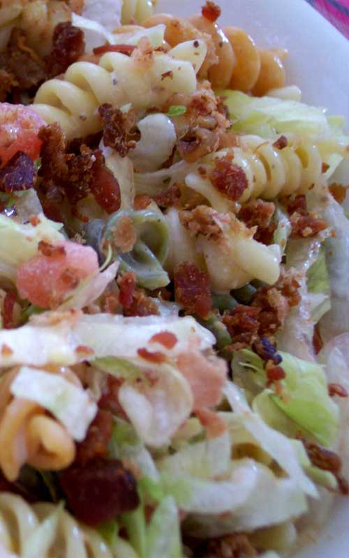 Recipe for BLT Pasta Salad - This is an easy and flavorful pasta salad that I'm always asked to bring to potlucks. You can have it ready in under 20 minutes! It is really that easy.