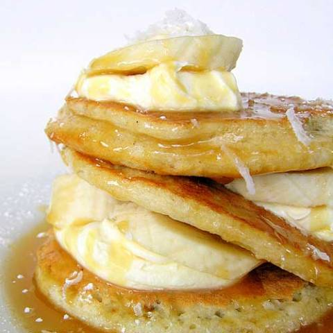 Recipe for Coconut Pancakes With Caramel Sauce - This is one of the most delicious stacks of pancakes I have ever eaten. And it's super sweet. But that's okay, because the tang from the creme fraiche balances everything out perfectly.