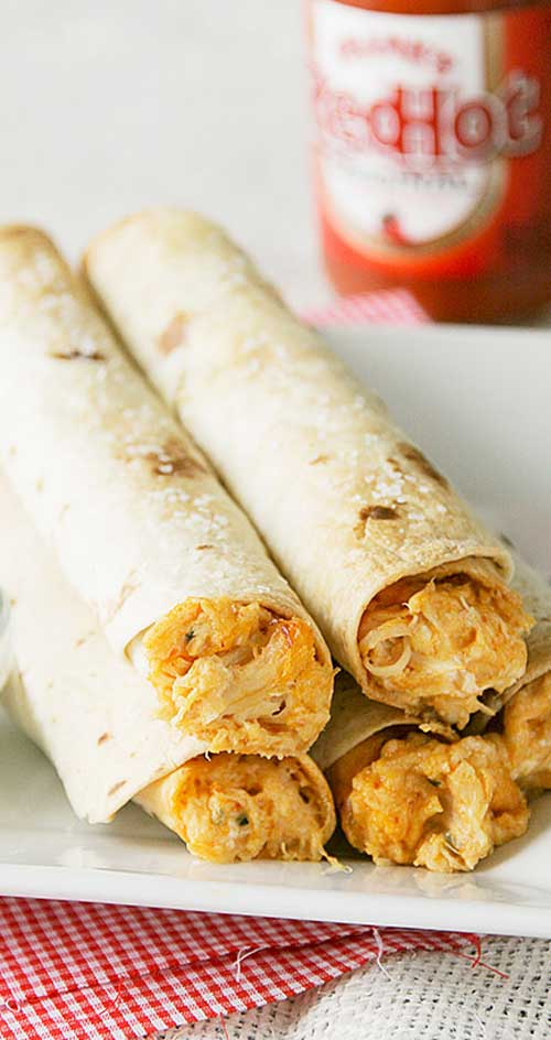 Any Buffalo chicken lover will love these Baked Buffalo Chicken Taquitos. Perfect for any party or just a snack!