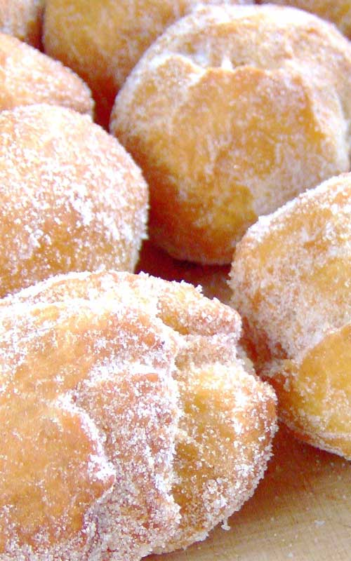 Hawaiian Doughnuts  (or Malasadas) are one of the all time favorite snacks. If you make these, prepare to rapidly become more popular with all of your friends.