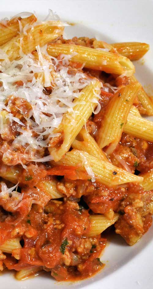 Quick-to-grab ingredients make this hearty Penne with Meat Sauce super easy. The start-to-finish time: 25 minutes. #pastarecipe #easyrecipe #easydinner