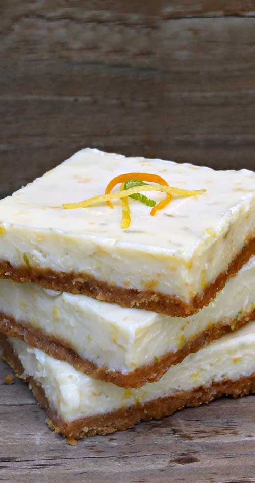 Next time you have a taste for citrus…change things up a bit and try these triple citrus bars. You won't be sorry. #dessertbars #cirusrecipe #kidfriendly