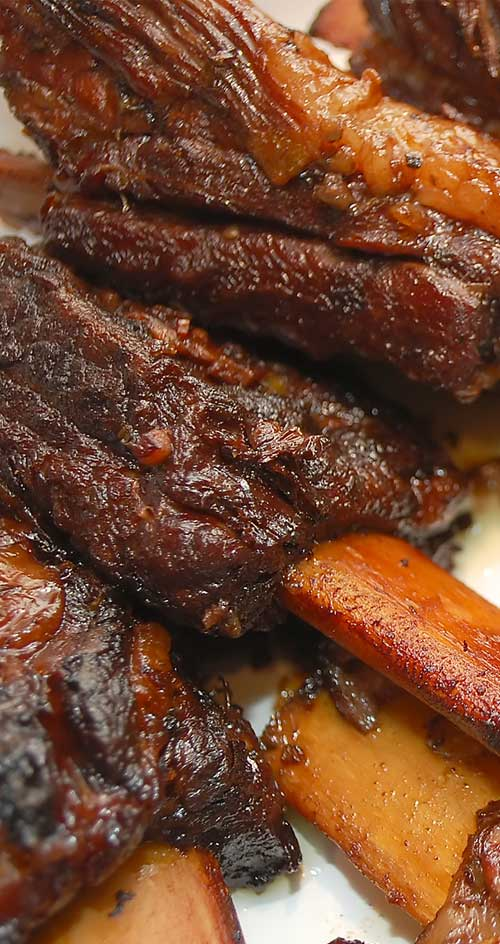 These flavorful braised short ribs perfectly illustrate how braised meat cooked on the bone can turn out succulent and tender enough to cut with a fork.  #beef #shortribs #ribs