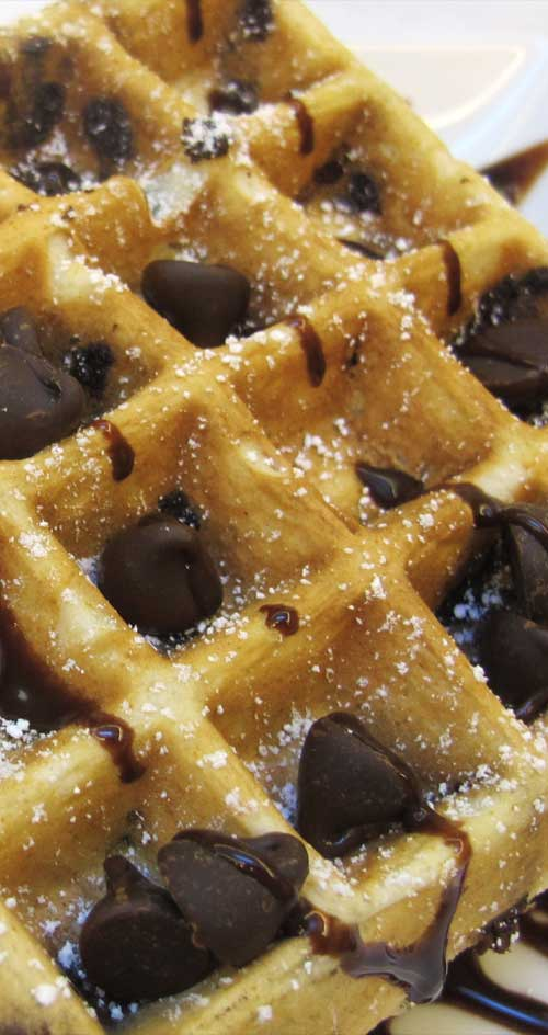These amazing Chocolate Chip Belgian Waffles are more like a decadent dessert than anything else. Incredibly quick and simple to make, a perfect start to any morning! #wafflerecipe #breakfastrecipe #chocolateforbreakfast