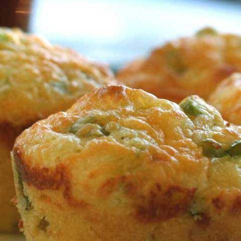 The only thing better than cornbread is cornbread with the cheese baked in! This Cheddar and Green Onion Cornbread Muffins recipe shows you how to make your own.