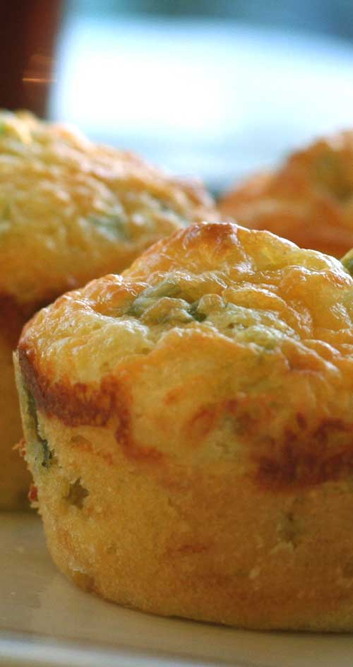 The only thing better than cornbread is cornbread with the cheese baked in! This Cheddar and Green Onion Cornbread Muffins recipe shows you how to make your own. #cornbreadrecipe #muffinrecipe #cheese